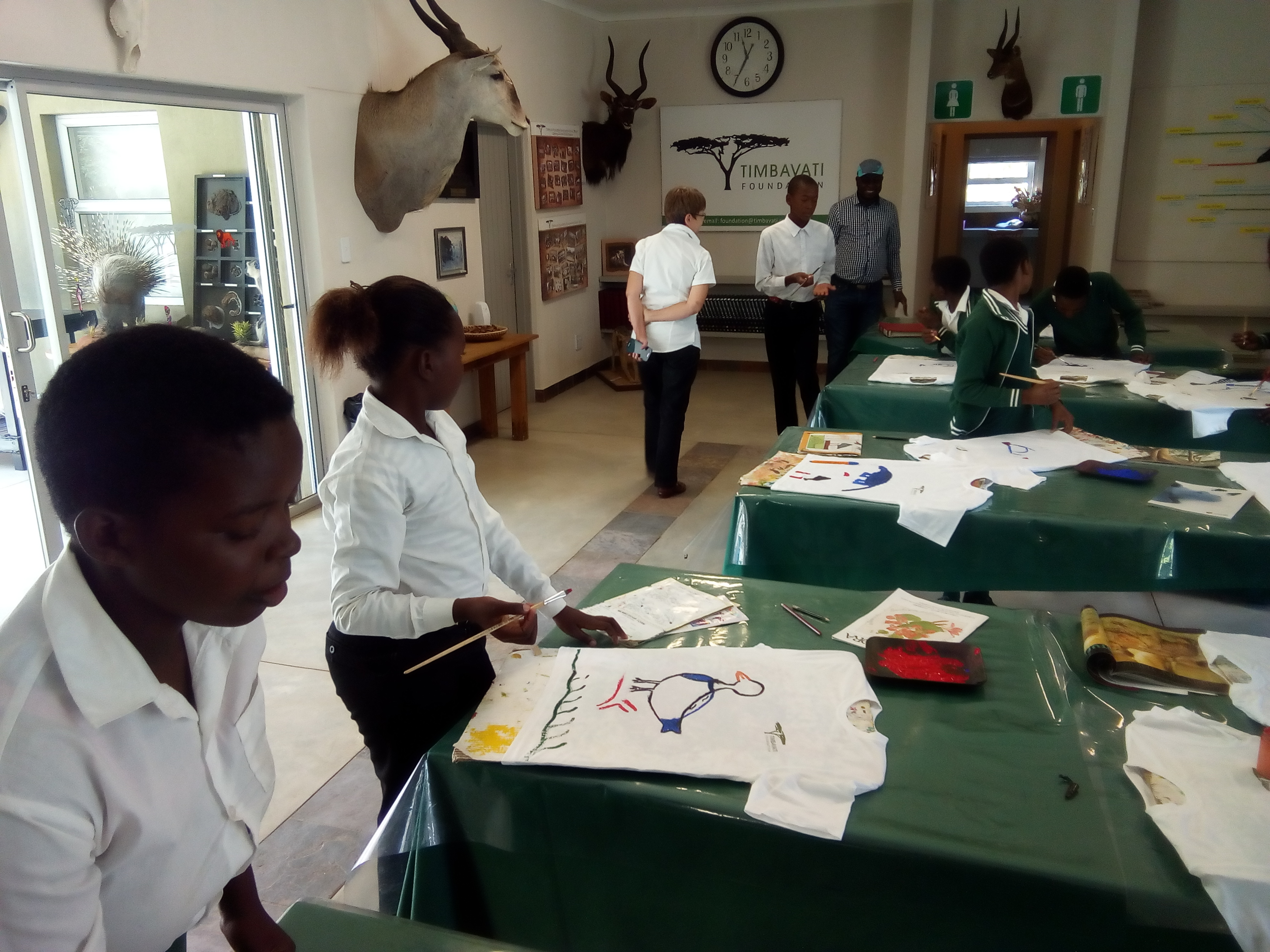 The Timbavati Foundation Manager enjoying the art work of the students