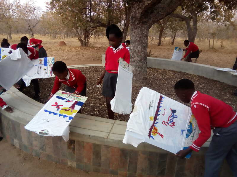 Students Hanging Their Painted T-Shirts Out To Dry