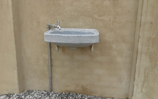Wash up basin outside of a newly built toiletblock