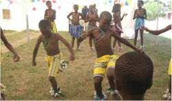 Youngsters enjoying themselves in dance and song.